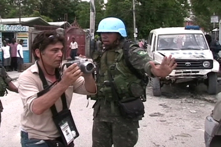 Kevin Pina being accosted by Haiti's uniformed and authorized terrorists